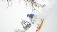 SLO MO Backcountry skier jumping in powder snow