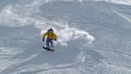 SLO MO Backcountry skier riding the sunny slope