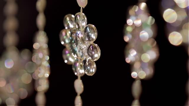 Background bead curtain moving slowly