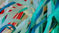 background - chaotic movement of multi-colored stripes