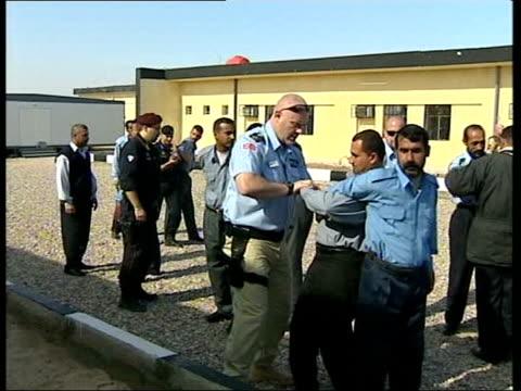 Basra bombings ITN LIB IRAQ British troops training Iraqi police cadets