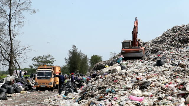 Backhoe at garbage dump