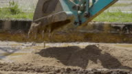 Backhoe Pouring Sand Slow Motion.