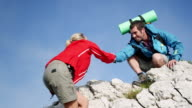 Backpacker climbing a mountain