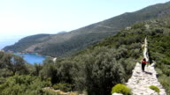 Backpacker is walking on the ancient water arch wall in Kalkan