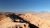 Backpacker taking pictures in Atacama desert