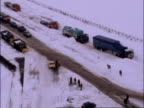 Bad weather continues / Cars stranded in snow ENGLAND Lincolnshire VIEWs cars and lorries struck in snow drifts with some motorists at side of road...