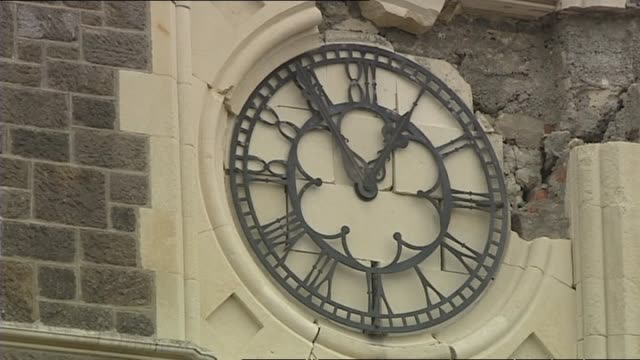 Badly damaged Christ Church Cathedral with broken roof and stained glass windows clock stopped shortly after earthquake struck before 1PM and New...