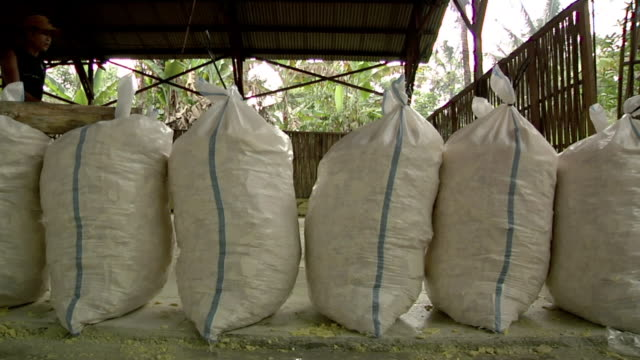 MS Bags of sulfur rocks ready to be sold / Ijen, Java, Indonesia