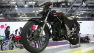 A Bajaj Auto Ltd RE60 vehicle sits on display at the 12th Auto Expo 2014 in Noida India on Friday Feb 7 Pan from Bajaj Auto Ltd RE60 vehicles to sign...