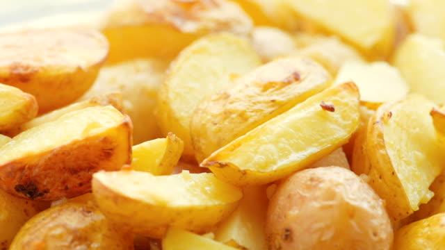 baked sliced potato, closeup