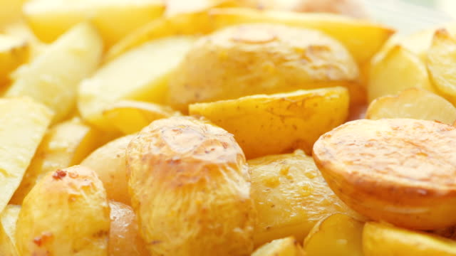 baked sliced potatoes on the plate