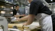 Baker cutting dough with a cutter wheel