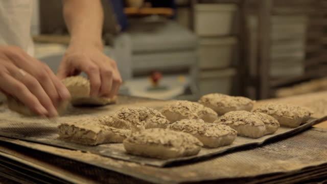 CU R/F PAN Baker making buns / Copenhagen, Seeland, Denmark