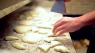 Baker preparing ciabatta bread