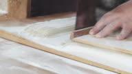 Baker slices dough