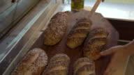 MS TD Baker tapping freshly baked bread / Copenhagen, Seeland, Denmark