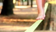 Balancing barefoot on a slackline