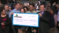 KTLA Balbil Atwal whose Chino Hills 7Eleven sold a winning Powerball ticket accepts a $1 million check from lottery officials