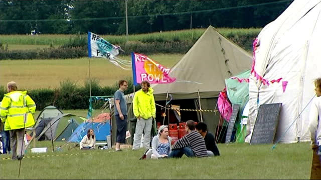 Sussex Balcombe EXT Protesters along in antifracking protest camp / 'Power to the People' on tent / protesres at camp with 'reclaim the power' flags...