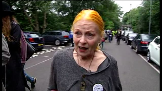Vivienne Westwood ENGLAND West Sussex Balcombe EXT Protesters along railway platform past police officers / Vivienne Westwood arrival with others...