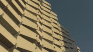 balconies  of an apartment tower in sunset