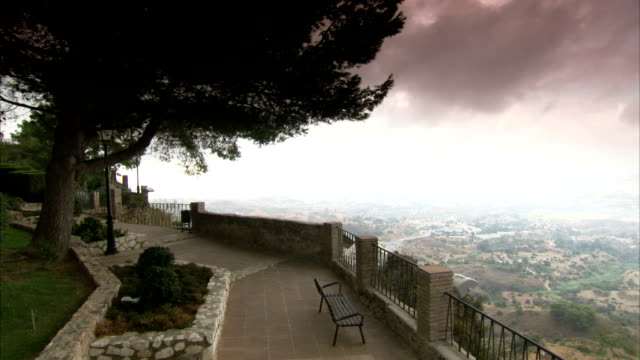 A balcony overlooks the Mijas countryside in Spain.