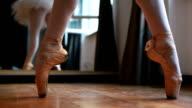 Balerina practicing indoors