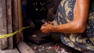 LS Balinese Woman Peeling The Garlic