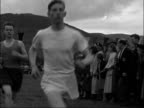 Aberdeenshire Ballater Pan over car park to general area of games Start of hill climb runners leave past camera Runners past Pipers towards not...