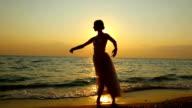 ballerina dancing on the beach