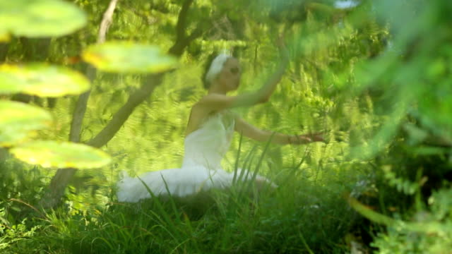 Ballerina dancing reflection in the pond