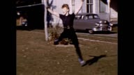 1953 Ballerina Practicing in Backyard