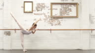 Ballerina warms up in the studio