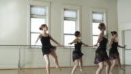 ballerinas dancing in unison