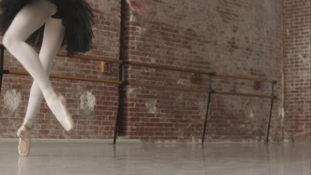 Ballerinas feet Pirouette on pointe in dance studio