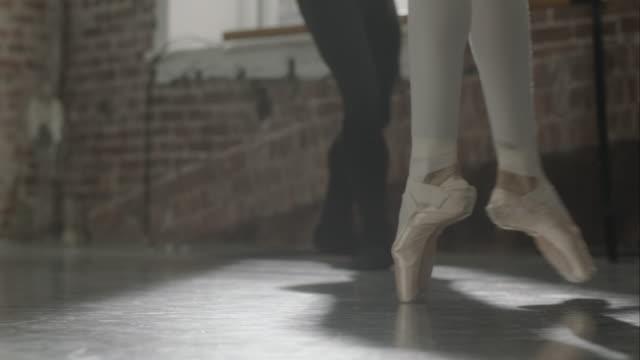 Ballet dancers feet rehearsing in dance studio