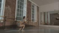 Ballet dancers in dance studio rehearsing together