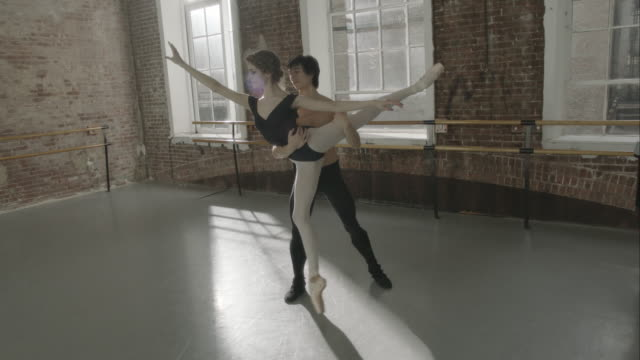 Ballet dancers rehearsing together in dance studio