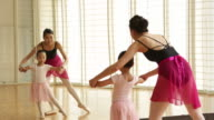 WS Ballet teacher and young student during dance class.