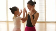 MS Ballet teacher congratulating young student.