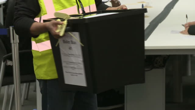 Ballot boxes arrive at counting halls across the country after day of voting at the polls Shows interior shots ballot boxes arriving at Southwark...