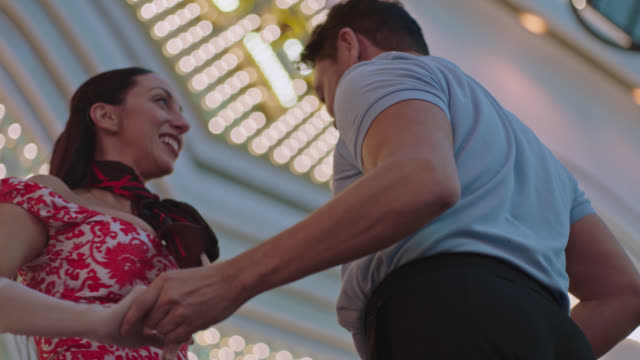 SLO MO. Ballroom dancers with vintage style perform outside casino in Downtown Las Vegas.