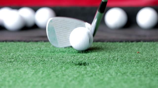 Balls Being Hit At Golf Range