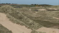 Balmedie Beach marram grass along sand dunes waves pond UK Balmedie Country Park Aberdeenshire