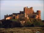 Bamburgh Castle on hill / Bamburgh, Northumberland, England