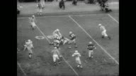 Band and cheerleaders perform in front of huge crowd for football game between the Baltimore Colts and the Green Bay Packers / game begins / specific...