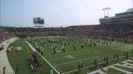 WS Band in football stadium with people / Unspecified