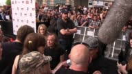 AC/DC band members Malcolm Young Cliff Williams Angus Young and Brian Johnson sign for fans and talk to reporters at the Exclusive World Premiere Of...