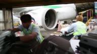 A Bangkok Airways Co aircraft taxis on the tarmac at Hong Kong International Airport in Hong Kong China on Monday Nov 3 A portable staircase is moved...